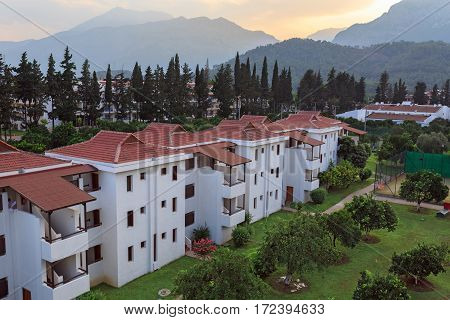 KEMER/ TURKEY - AUGUST 24. Aerial view of the bungalows on tangerine alley and mountains during sunset on August 24, 2015 in city Kemer, Turkey.