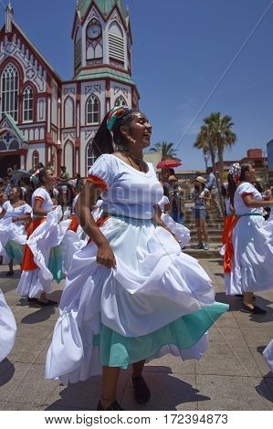 ARICA, ARICA and PARINACOTA, CHILE - FEBRUARY 10, 2017: Female dancers from the group Tumba Carnaval, performing at the annual street carnival celebrating the strength of the sun.