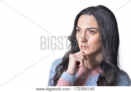 beautiful brunette young woman with facial expression close up, against white