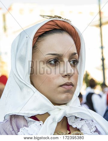 QUARTU S.E., ITALY - September 15, 2012: Parade of the Wine Festival 2012 - Sardinia - portrait of a beautiful girl in traditional Sardinian costume