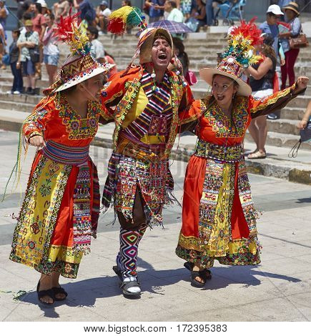 ARICA, ARICA and PARINACOTA, CHILE - FEBRUARY 10, 2017: Men and women of the group Thinkus Rupay Masis, performing at the annual street carnival celebrating the strength of the sun.