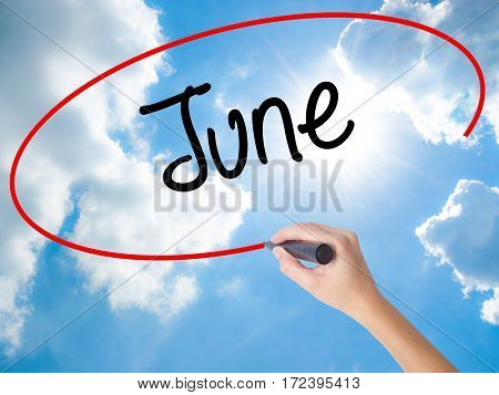 Woman Hand Writing June  With Black Marker On Visual Screen