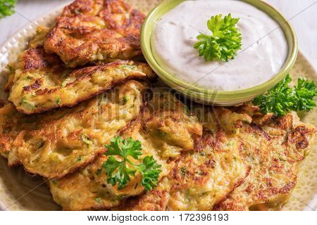 Vegetable fritters with potato, carrot and zucchini served with Ranch sauce.