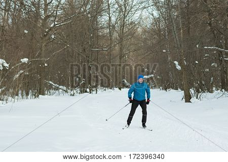 The Man On The Cross-country Skiing In Winter Forest.