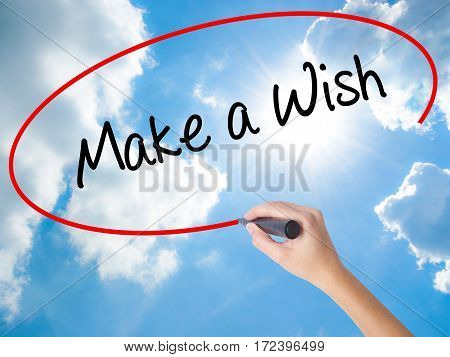 Woman Hand Writing Make A Wish  With Black Marker On Visual Screen