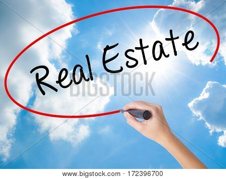 Woman Hand Writing Real Estate  With Black Marker On Visual Screen