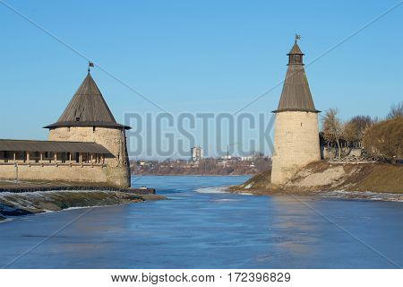 Two ancient towers of the Pskov Two ancient towers of the Pskov Kremlin on the place of confluence of Pskova and Velikaya rivers in the sunny February afternoon. Russia