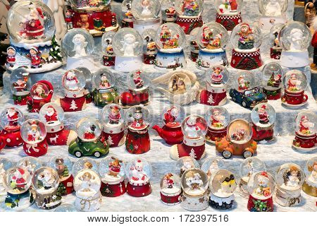 DUISBURG GERMANY - DECEMBER 17 2016: Christmas stall with snow balls and several small puppets