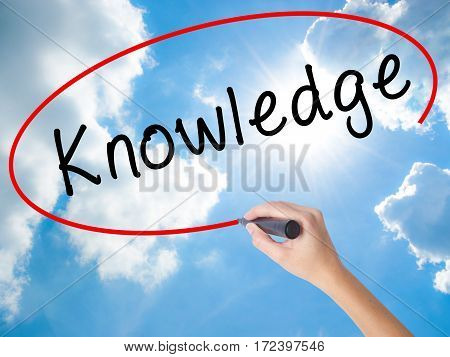 Woman Hand Writing Knowledge With Black Marker On Visual Screen