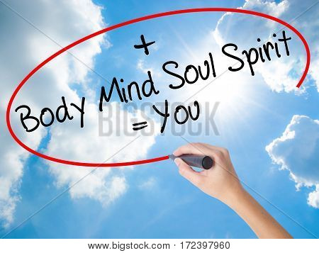 Woman Hand Writing Body + Mind + Soul + Spirit = You With Black Marker On Visual Screen