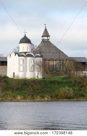 Ancient church of St. George and the tower of the old Ladoga fortress, cloudi October day. Leningrad region. Russia