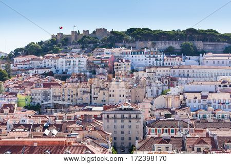 View of Alfama, the old neighborhood of Lisbon and and St. George's Castle, from the Santa Justa Lift