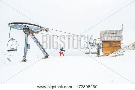 Cable car, wooden cottage and snow in Montenegro