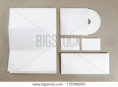 Blank stationery set. Corporate identity template on kraft paper background. Blank objects for placing your design. Top view.