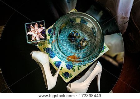 Goldfish In A Round Goldfish Bowl With Colorfull Plants