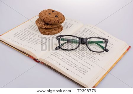 Chocolate Chip Cookies And Glasses On A Book
