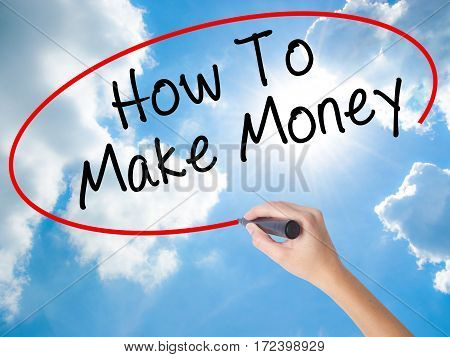 Woman Hand Writing How To Make Money With Black Marker On Visual Screen