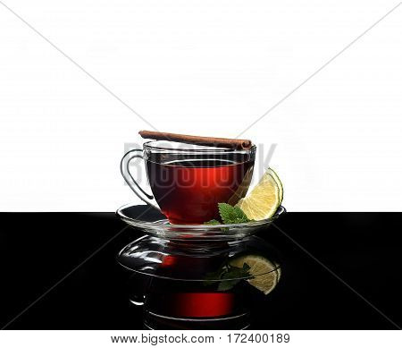 A cup of fragrant tea with fresh mint and lemon