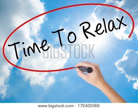 Woman Hand Writing Time To Relax With Black Marker On Visual Screen