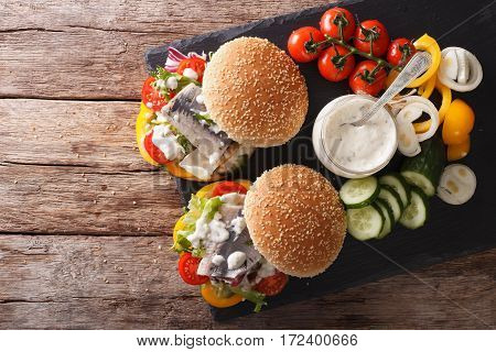 Fishburger With Herring, Gravy And Fresh Vegetables Close-up. Horizontal Top View