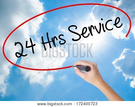 Woman Hand Writing 24 Hrs Service With Black Marker On Visual Screen