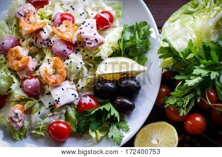 bright salad with feta cheese and tomato and shrimp sauce very tender