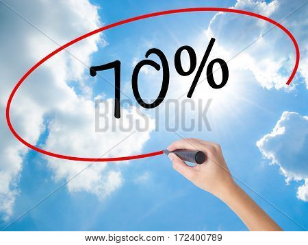 Woman Hand Writing 70% With Black Marker On Visual Screen