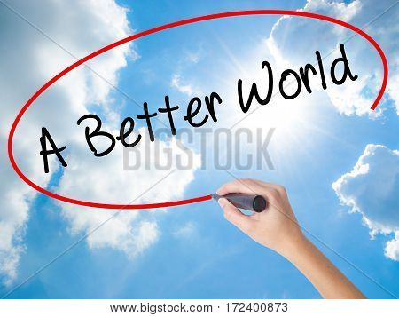 Woman Hand Writing A Better World With Black Marker On Visual Screen