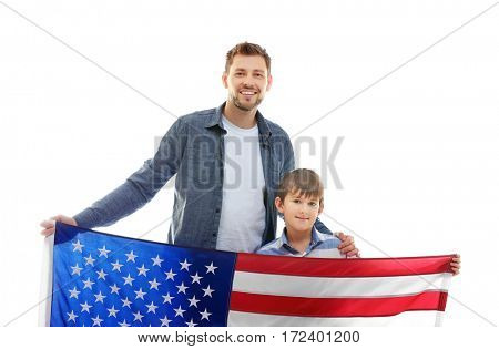 Happy father with son holding American flag on white background