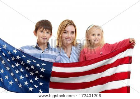 Happy mother with children holding American flag on white background