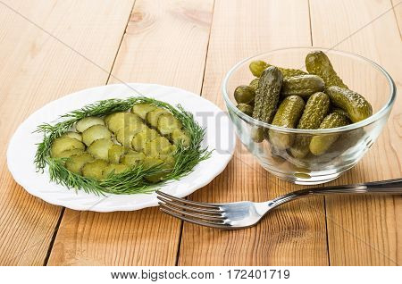 Slices Of Pickled Gherkins With Dill In White Plate