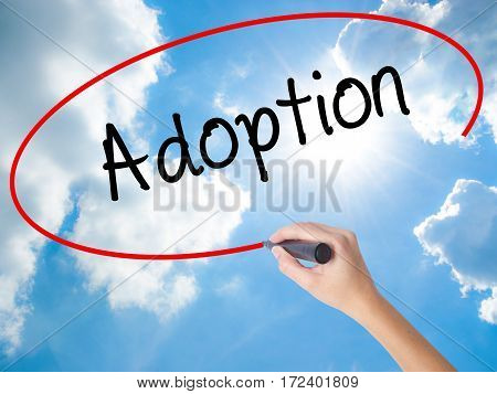 Woman Hand Writing Adoption With Black Marker On Visual Screen