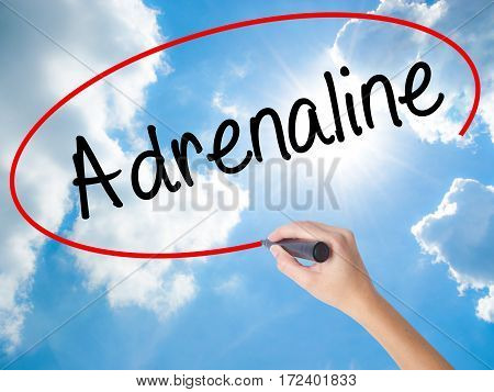 Woman Hand Writing Adrenaline  With Black Marker On Visual Screen