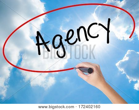 Woman Hand Writing Agency With Black Marker On Visual Screen