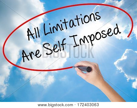 Woman Hand Writing All Limitations Are Self Imposed With Black Marker On Visual Screen