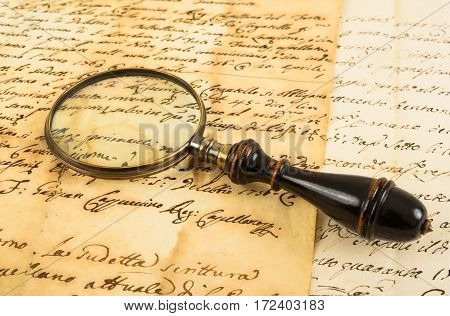 Old magnifying glass on an old handwriting