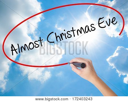 Woman Hand Writing Almost Christmas Eve With Black Marker On Visual Screen