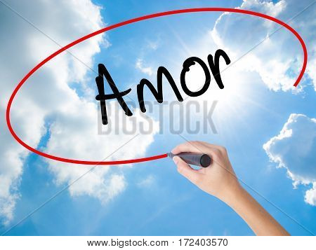 Woman Hand Writing Amor ( Love In Portuguese)with Black Marker On Visual Screen