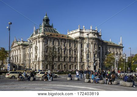 MUNICH, GERMANY - OCTOBER 31, 2015: The palace of justice in Munich is a judicial and administrative building in the Bavarian capital unidentified people are walking along