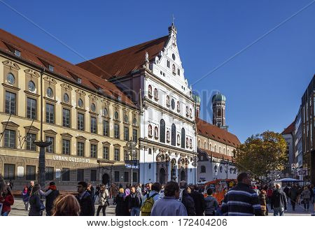 MUNICH, GERMANY - OCTOBER 31, 2015: St. Michael is a Jesuit church in the inner city of Munich and one of the largest Renaissance churches in Europe unidentified people are walking along
