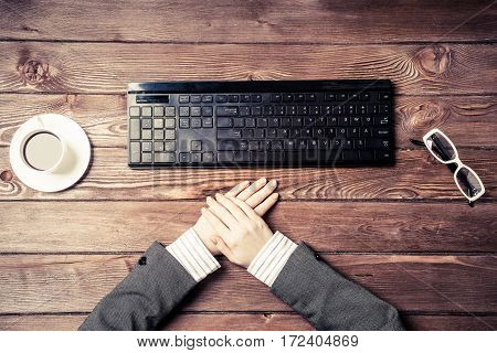 Female hands black keyboard and coffee cup on table