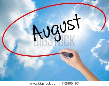 Woman Hand Writing August  With Black Marker On Visual Screen