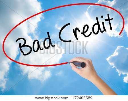 Woman Hand Writing Bad Credit With Black Marker On Visual Screen