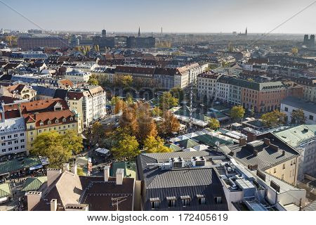MUNICH, GERMANY - OCTOBER 31, 2015: Aerial view on the at the Viktualienmarkt a typical farmers market in the inner city of Munich
