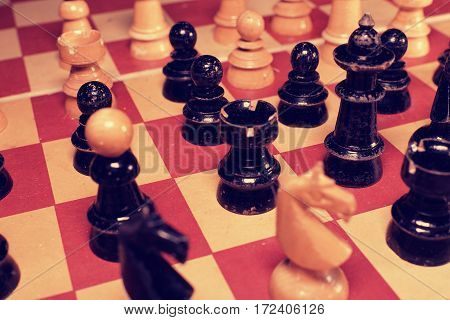Vintage wooden chess pieces. Retro effect. Black & white pieces.