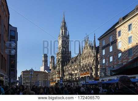 MUNICH, GERMANY - OCTOBER 31, 2015: Marienplatz also called Mary's Square with the new city hall is one of the most vital places in Munich and unidentified people are walking along