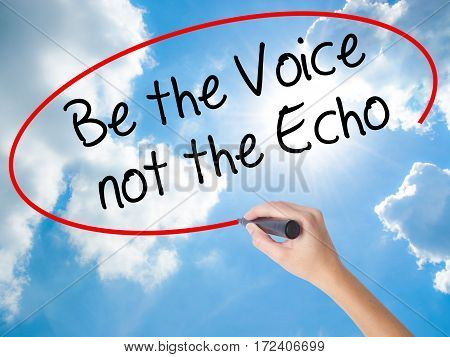 Woman Hand Writing Be The Voice Not The Echo With Black Marker On Visual Screen.