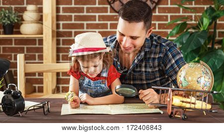 Happy family of father and child daughter prepareto travel trip learn for route map