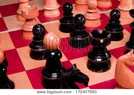 Vintage wooden chess pieces. Black & white pieces.
