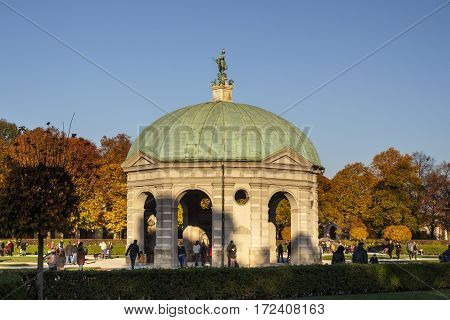 MUNICH, GERMANY - OCTOBER 31, 2015: The Hofgarten (Court Garden) with the pavilion for the goddess Diana is a garden in the center of Munich Germany located between the Residenz and the Englischer Garten